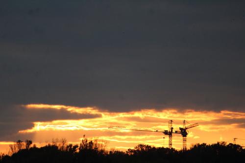 Słońce i dźwigi